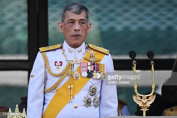 Thailand's King Maha Vajiralongkorn appears on the balcony of Suddhaisavarya Prasad Hall of the Grand Palace during a public audience on the final...