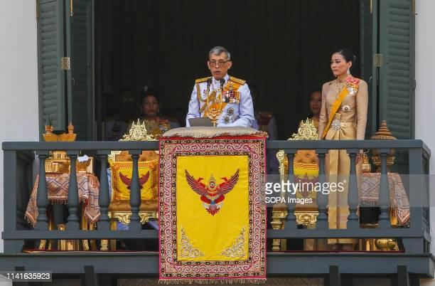 Thailand's King Maha Vajiralongkorn Bodindradebayavarangkun and Queen Suthida appear on the balcony of Suddhaisavarya Prasad Hall of the Grand Palace...