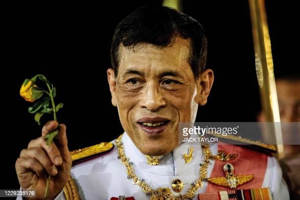 Thailand's King Maha Vajiralongkorn greets royalist supporters after a Buddhist ceremony for the late king Chulalongkorn in Bangkok on October 23,...