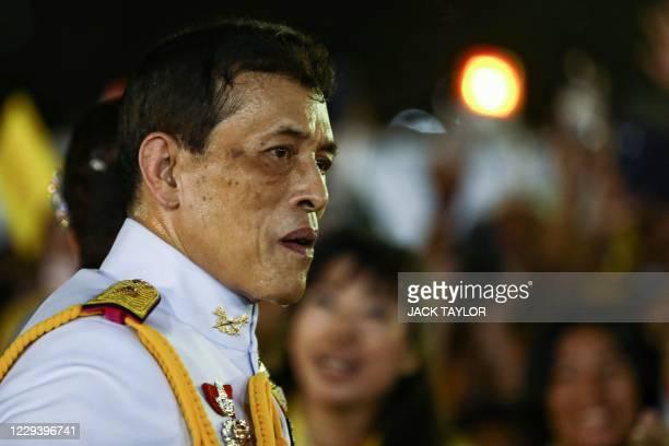 Thailand's King Maha Vajiralongkorn greets supporters outside the Grand Palace in Bangkok on November 1, 2020 after presiding over a religious...