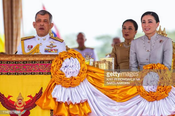 Thailand's King Maha Vajiralongkorn is accompanied by Queen Suthida as he presides the annual royal ploughing ceremony near the Grand Palace in...