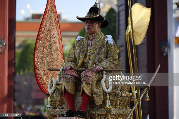 Thailand's King Maha Vajiralongkorn is carried in a golden palanquin out of the Grand Palace for the coronation procession in Bangkok on May 5 2019