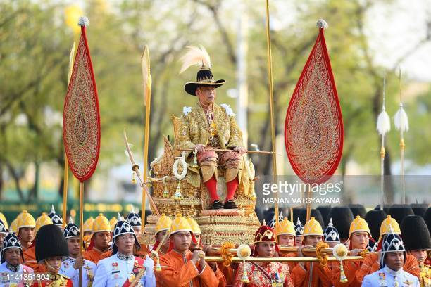TOPSHOT Thailand's King Maha Vajiralongkorn is carried in a golden palanquin during the coronation procession as Princess Bajrakitiyabha Mahidol and...