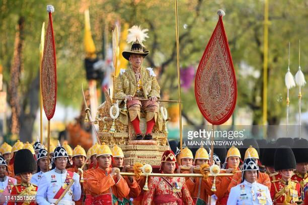 TOPSHOT Thailand's King Maha Vajiralongkorn is carried in a golden palanquin during the coronation procession as Princess Bajrakitiyabha Mahidol and...