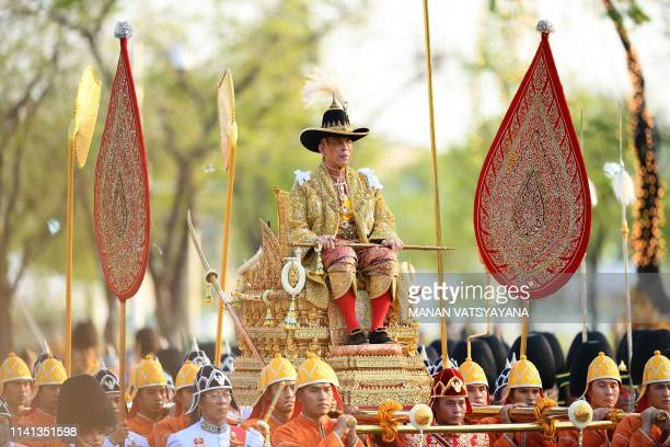 TOPSHOT Thailand's King Maha Vajiralongkorn is carried in a golden palanquin during the coronation procession in Bangkok on May 5 2019