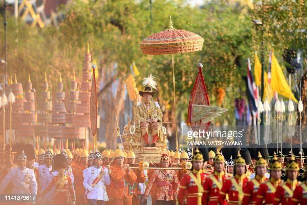 TOPSHOT Thailand's King Maha Vajiralongkorn is carried in a golden palanquin during the coronation procession in Bangkok on May 5 2019