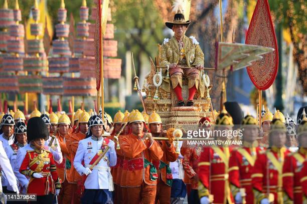 TOPSHOT Thailand's King Maha Vajiralongkorn is carried in a golden palanquin during the coronation procession as daughter Princess Bajrakitiyabha...