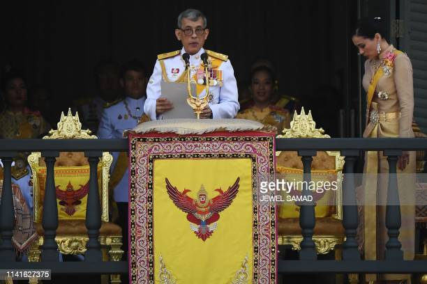 Thailand's King Maha Vajiralongkorn makes a speech beside Queen Suthida from the balcony of Suddhaisavarya Prasad Hall of the Grand Palace as they...