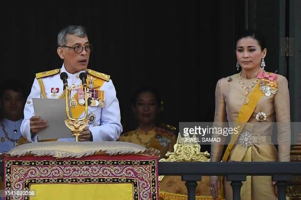 Thailand's King Maha Vajiralongkorn makes a speech beside Queen Suthida on the balcony of Suddhaisavarya Prasad Hall of the Grand Palace as they...
