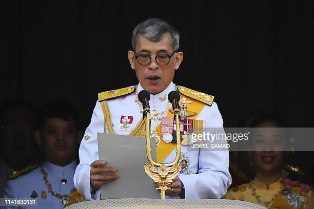 Thailand's King Maha Vajiralongkorn makes a speech from the balcony of Suddhaisavarya Prasad Hall of the Grand Palace as they grant a public audience...
