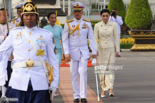 Thailand's King Maha Vajiralongkorn Queen Suthida and his daughter Princess Bajrakitiyabha arrive to pay their respect at King Rama V monument in...