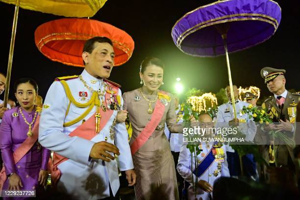 Thailand's King Maha Vajiralongkorn Queen Suthida and Princess Bajrakitiyabha Mahidol greet royalist supporters after a Buddhist ceremony for the...
