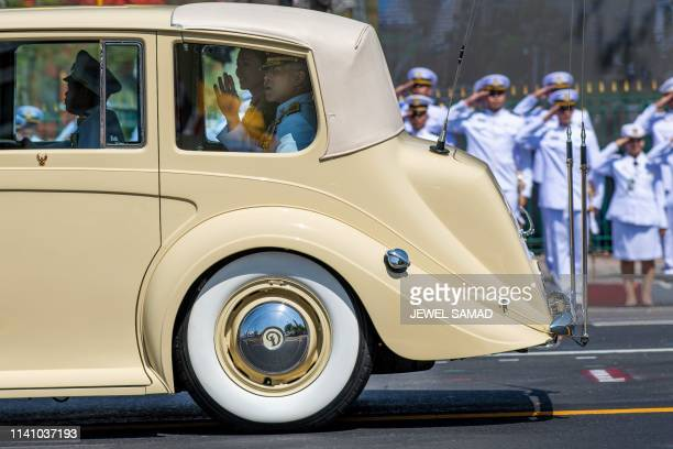 TOPSHOT Thailand's King Maha Vajiralongkorn waves as he arrives with Queen Suthida at the Grand Palace for his coronation in Bangkok on May 4 2019