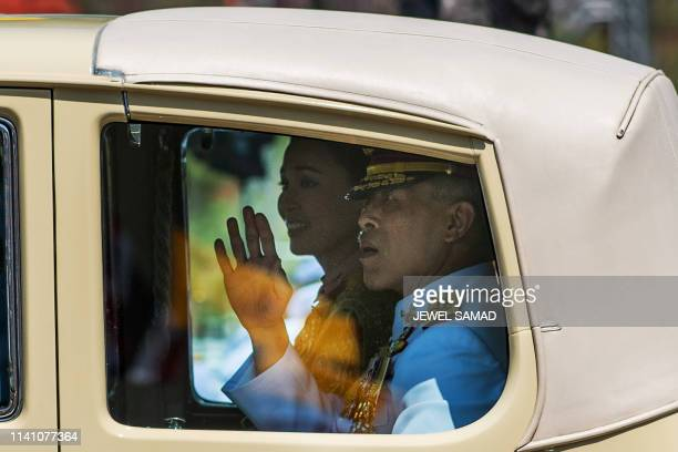 TOPSHOT Thailand's King Maha Vajiralongkorn waves as he arrives with Queen Suthida at the Grand Palace for his coronation in Bangkok on May 4 2019 /...