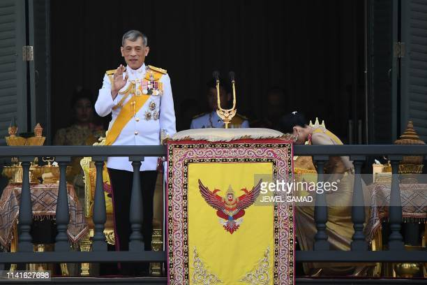 Thailand's King Maha Vajiralongkorn waves beside Queen Suthida from the balcony of Suddhaisavarya Prasad Hall of the Grand Palace as they grant a...