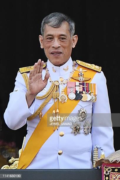 Thailand's King Maha Vajiralongkorn waves from the balcony of Suddhaisavarya Prasad Hall of the Grand Palace during a public audience on the final...