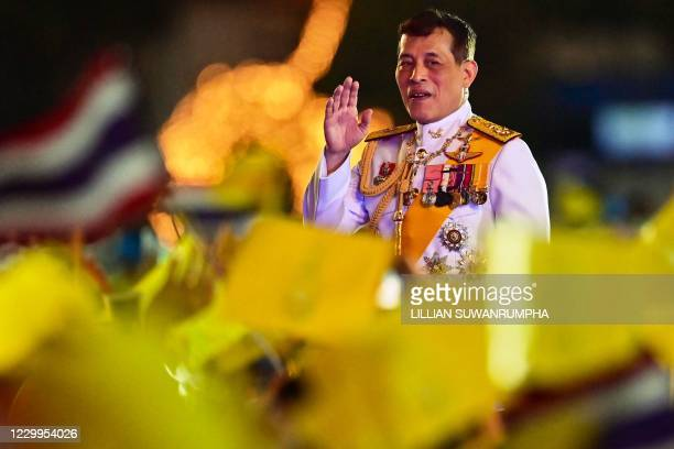 Thailand's King Maha Vajiralongkorn waves to royalist supporters during a ceremony to commemorate the birthday of his father the late Thai king...