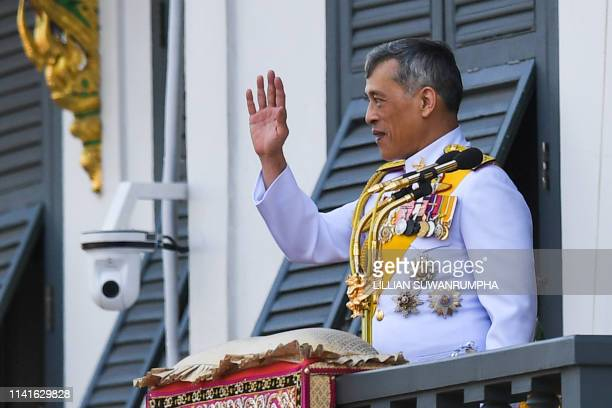 Thailand's King Maha Vajiralongkorn waves to well-wishers from the balcony of Suddhaisavarya Prasad Hall of the Grand Palace during a public audience...