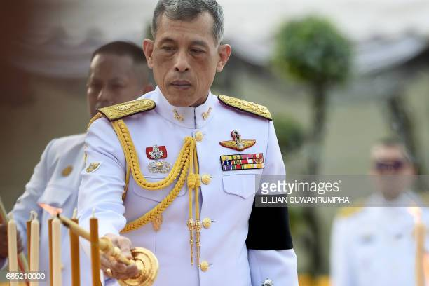 Thailand's King Vajiralongkorn pays respects at the statue of King Rama I after signing the militarybacked constitution in Bangkok on April 6 2017...