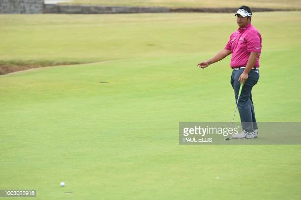 Thailand's Kiradech Aphibarnrat reacts after missing his par putt on the 18th green during his third round on day 3 of The 147th Open golf...