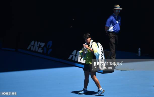 Thailand's Luksika Kumkhum gestures after her women's singles third round match against Croatia's Petra Martic on day five of the Australian Open...
