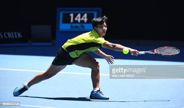 Thailand's Luksika Kumkhum hits a return against Croatia's Petra Martic during their women's singles third round match on day five of the Australian...