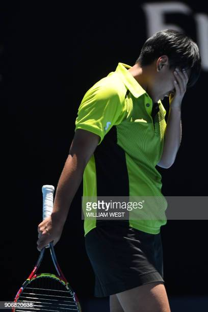 Thailand's Luksika Kumkhum reacts against Croatia's Petra Martic during their women's singles third round match on day five of the Australian Open...