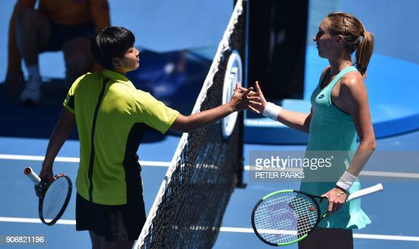 Thailand's Luksika Kumkhum shakes hands with Croatia's Petra Martic after their women's singles third round match on day five of the Australian Open...