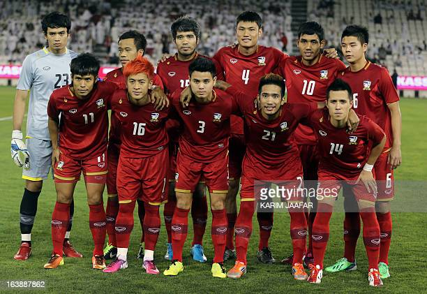 Thailand's national team pose for a picture prior to their friendly football match against Qatar in the capital Doha on March 17 2013 AFP PHOTO /...