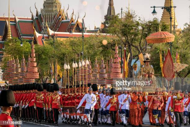 Thailand's newly crowned King Maha Vajiralongkorn is carried in a golden palanquin during the coronation procession on May 5 2019 in Bangkok Thailand...