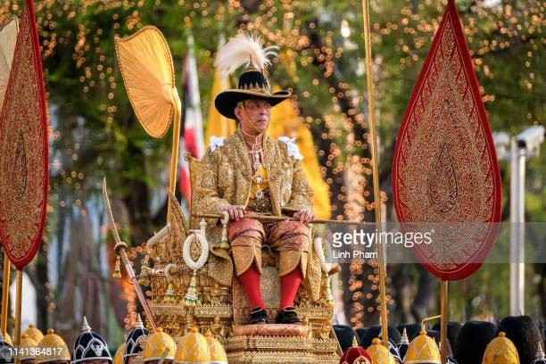 Thailand's newly crowned King Maha Vajiralongkorn is carried in a golden palanquin during the coronation procession on May 5, 2019 in Bangkok,...