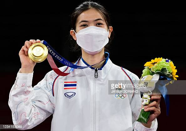 Thailand's Panipak Wongpattanakit celebrates with her gold medal on... News Photo - Getty Images