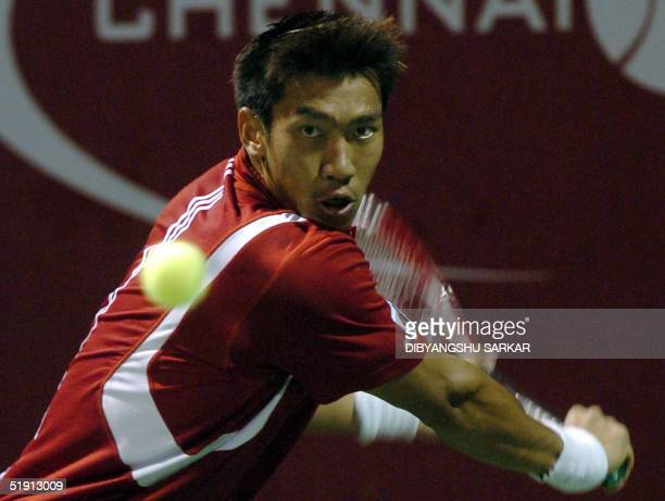 Thailand's Paradorn Srichaphan hits the ball during his first round match against Belgian Christophe Rochus during the Chennai Open Tennis...