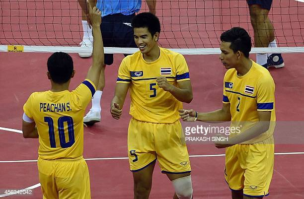 Thailand's Peachan Suriyan Kaokaew Pornchai and Sakha Siriwat celebrate after a point against South Korea in their men's team sepaktakraw final...