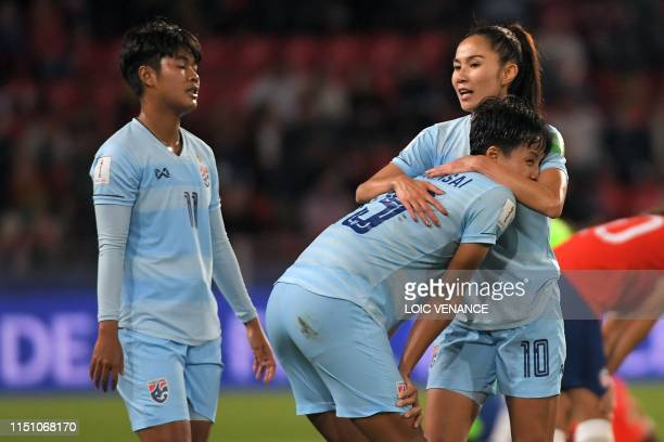 Thailand's players react at the end of the France 2019 Women's World Cup Group F football match between Thailand and Chile on June 20 at the Roazhon...