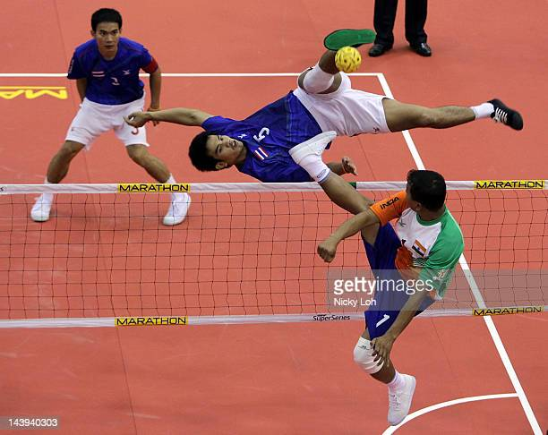 Thailand's Pornchai Kaokaew returns a shot to India during their semi final match on day four of the ISTAF Super Series at ITE Campus on May 6 2012...