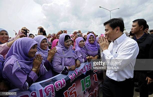 Thailand's Prime Minister Abhisit Vejjajiva greets wellwishers during a visit in the restive southern province of Narathiwat on April 30 2011 A...