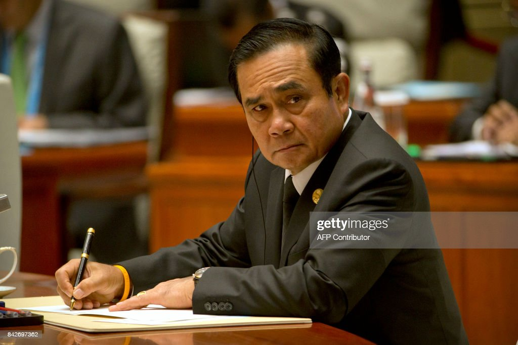 Thailands Prime Minister Prayut Chan-O-Cha attends the Dialogue of Emerging Market and Developing Countries on the sidelines of the 2017 BRICS Summit in Xiamen, southeastern China's Fujian Province on September 5, 2017. Xi opened the annual summit of BRICS leaders that already has been upstaged by North Korea's latest nuclear weapons provocation. / AFP PHOTO / POOL / Mark Schiefelbein