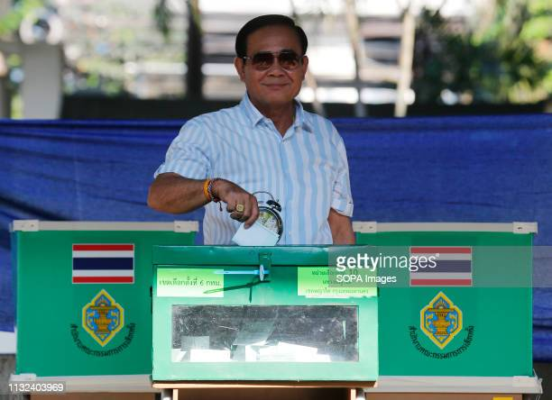 Thailand's Prime Minister Prayut Chanocha drops his vote into a ballot box during Thailand's general election in Bangkok