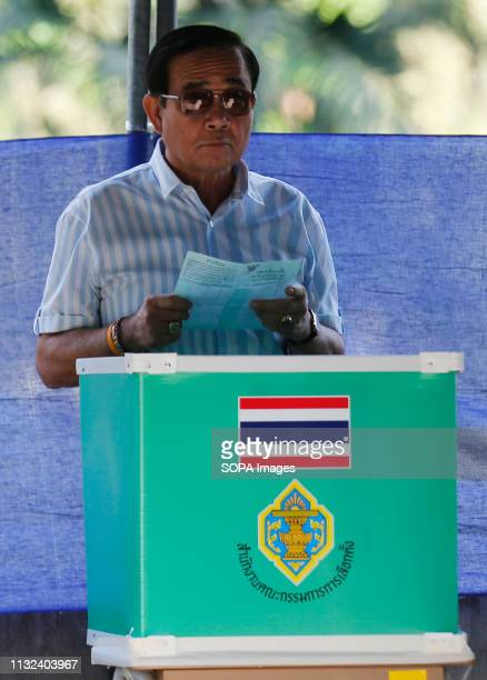 Thailand's Prime Minister Prayut Chanocha looks at his vote during Thailand's general election in Bangkok