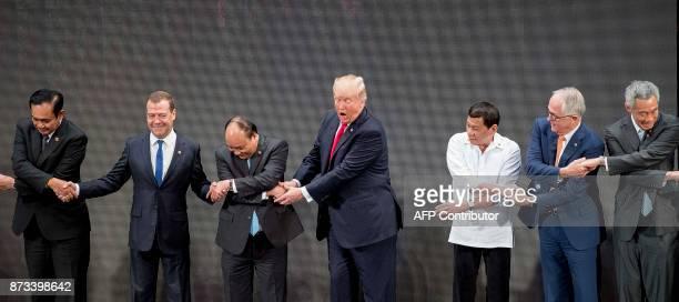 Thailand's Prime Minister Prayut ChanOCha Russian Prime Minister Dmitry Medvedev Vietnam's Prime Minister Nguyen Xuan Phuc US President Donald Trump...