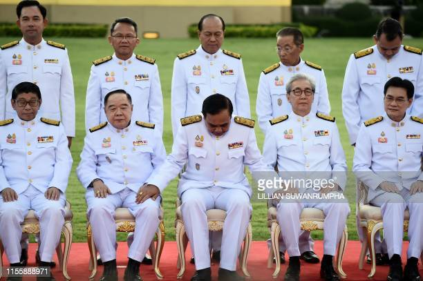 Thailand's Prime Minister Prayut Chan-O-Cha sits for a photo with members of the new Thai cabinet at Government House in Bangkok on July 16, 2019.