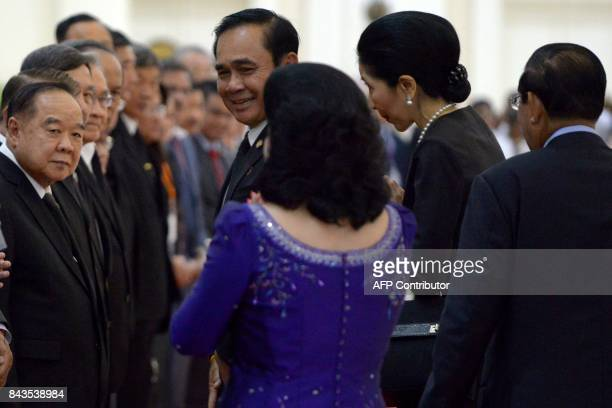 Thailand's Prime Minister Prayut ChanOCha smiles as his wife Naraporn Cambodia's Prime Minister Hun Sen and his wife Bun Rany walk behind upon...
