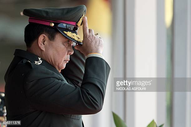 Thailand's Prime Minister Prayuth Chanocha gestures during a military parade marking his retirement as commander in chief of the Royal Thai Army at...