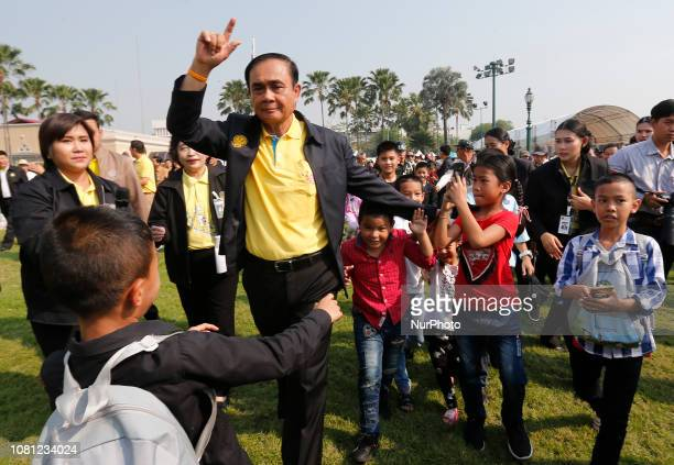 Thailand's Prime Minister Prayuth Chanocha walks with children during the Children's Day celebration at Government House in Bangkok Thailand on...