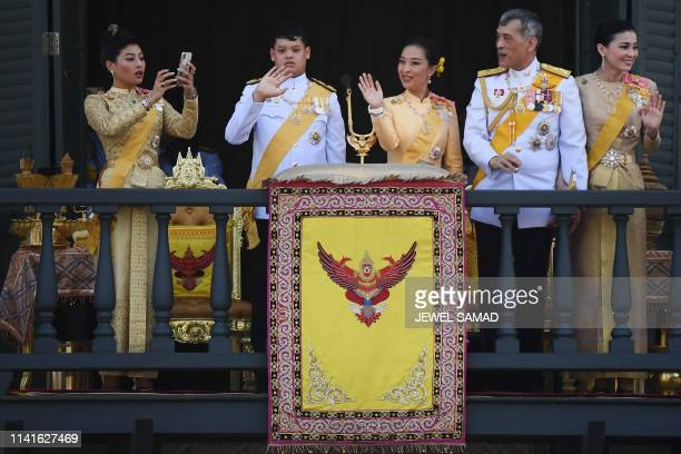 Thailand's Princess Sirivannavari Nariratana takes a photo as she stands with her brother Prince Dipangkorn Rasmijoti sister Princess Bajrakitiyabha...