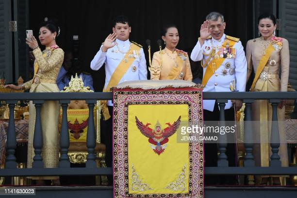 Thailand's Princess Sirivannavari Nariratana takes a photo as she stands with her brother Prince Dipangkorn Rasmijoti , sister Princess...
