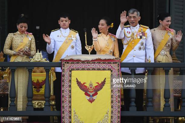 Thailand's Princess Sirivannavari Nariratana uses her mobile phone as her brother Prince Dipangkorn Rasmijoti, sister Princess Bajrakitiyabha...