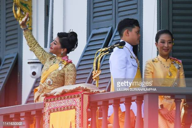 Thailand's Princess Sirivannavari Nariratana waves while her siblings Prince Dipangkorn Rasmijoti and Princess Bajrakitiyabha Mahidol leaves the...