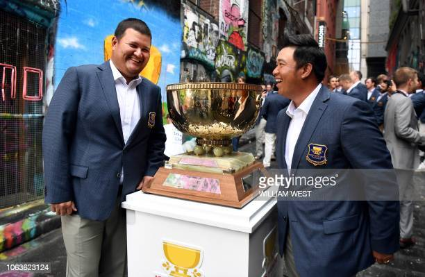 Thailand's Prom Meesawat and teammate Kiradech Aphibarnrat pose with the Golf World Cup trophy in Melbourne on November 20 ahead of the World Cup of...